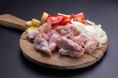 Raw chicken wings and ingredients for cooking on black backgroun Royalty Free Stock Photography