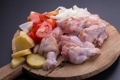 Raw chicken wings and ingredients for cooking on black backgroun Stock Photos