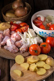 Raw chicken wings and ingredients for cooking on wooden backgrou. Nd Stock Images