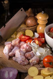 Raw chicken wings and ingredients for cooking on wooden backgrou. Nd Royalty Free Stock Photography