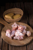 Raw chicken wings and ingredients for cooking on wooden backgrou Stock Image