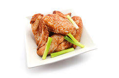 Raw Chicken Wings marinated. In soy sauce  on white Royalty Free Stock Photography