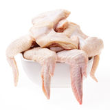Raw chicken wings. On plate, white background isolated Stock Image