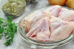 Raw chicken wings prepared for cooking. Raw chicken wings with vegetables and spices prepared for cooking Royalty Free Stock Photos