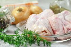 Raw chicken wings prepared for cooking. Raw chicken wings with vegetables and spices prepared for cooking Stock Photos