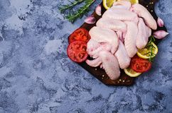 Raw chicken wings. With spices and vegetables. Selective focus Royalty Free Stock Images