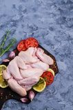 Raw chicken wings. With spices and vegetables. Selective focus Royalty Free Stock Photos