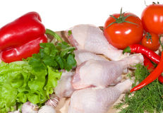 Raw chicken wings with vegetables. On chopping board Stock Photo