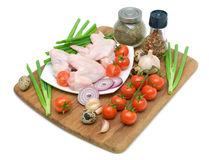 Raw chicken wings, vegetables and eggs on a white background Stock Photos