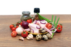 Raw chicken wings, vegetables and eggs on a wooden table Royalty Free Stock Image
