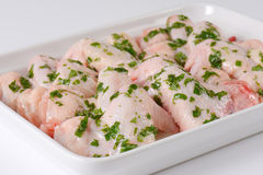 Raw chicken wings in white baking dish. Raw chicken wings with chopped parsley in white ceramic baking dish Stock Photo