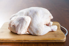 Raw chicken. On wooden board Royalty Free Stock Photos
