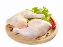 Raw chicken on a wooden cutting board royalty free stock photo
