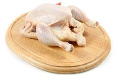 Raw chicken on wooden hardboard Stock Photography