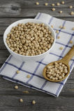 Raw chickpeas in a bowl on the wooden table Stock Photography
