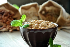 Raw chickpeas in a brown bowl Royalty Free Stock Photos