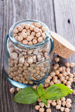 Raw chickpeas in a glass jar Royalty Free Stock Images