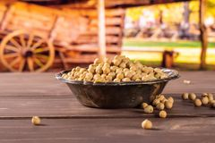 Raw chickpeas kabuli with cart Royalty Free Stock Photo