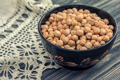 Raw chickpeas in wooden bowl Stock Images