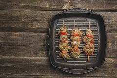 raw chiken meat with vegetables on skewers on grill cast iron pan royalty free stock image