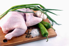 Raw chiken with pepper. spices and garlic Stock Photos
