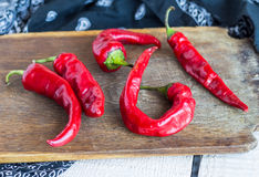 Raw chili pepper on a cutting board, raw food Stock Photos