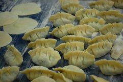 Raw chinese dumplings Royalty Free Stock Image