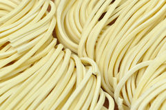 Raw chinese noddle background Stock Images