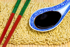 Raw chinese noodles with soy sauce Stock Images