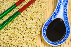 Raw chinese noodles with soy sauce Royalty Free Stock Photos