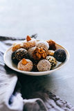 Raw chocolate candy. With nuts, figs and citrus, truffle, healthy Stock Photo