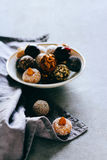 Raw chocolate candy with nuts. Figs and citrus, truffle, healthy Stock Images
