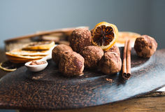 Raw chocolate candy with nuts, figs and citrus, truffle Stock Photography