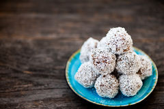Raw chocolate truffles. Homemade raw chocolate truffles with nuts and coconut flakes Royalty Free Stock Image