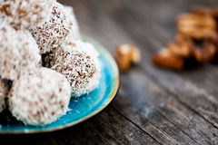 Raw chocolate truffles. Homemade raw chocolate truffles with nuts and coconut flakes Stock Photography