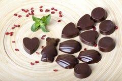 Raw chocolates in the shape of bears, hearts, seashells royalty free stock image