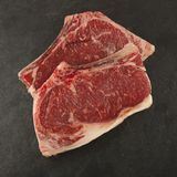 Raw chop meat on a slate plate. Rustical bbq Stock Photography