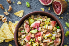 Raw chopped figs, walnuts, pistachios and honey with soft cheese in a bowl Royalty Free Stock Image