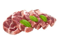 Raw chuck steak. With basil on white plate Stock Images