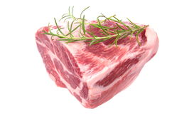 Raw chuck steak. With rosemary on white background Royalty Free Stock Images