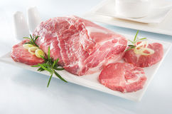 Raw chuck steak with tableware. On white background Royalty Free Stock Photo