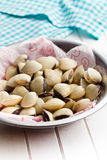 Raw clams in bowl Stock Photography