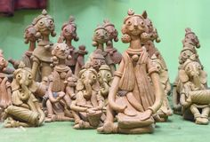 Terracota tribal musicians sitting with their instruments royalty free stock image