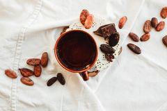 Raw cocoa cacao beans, black chocolate on brown sacking, top v Stock Photo