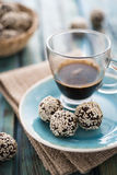 Raw cocoa candies with sesame seeds Stock Photos
