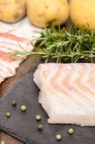 Raw cod in vertical format. Raw cod with potatoes in vertical format Stock Photo