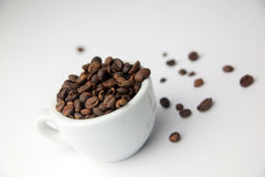 Raw cofee. And cup on white background royalty free stock image