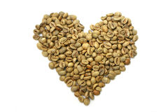Raw Coffee Beans. In heart shape isolated on white Royalty Free Stock Photos