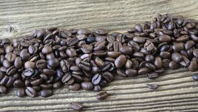 Raw coffee beans. Coffee beans on wood background stock video