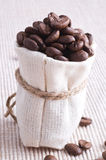 Raw coffee in small sack Royalty Free Stock Photo